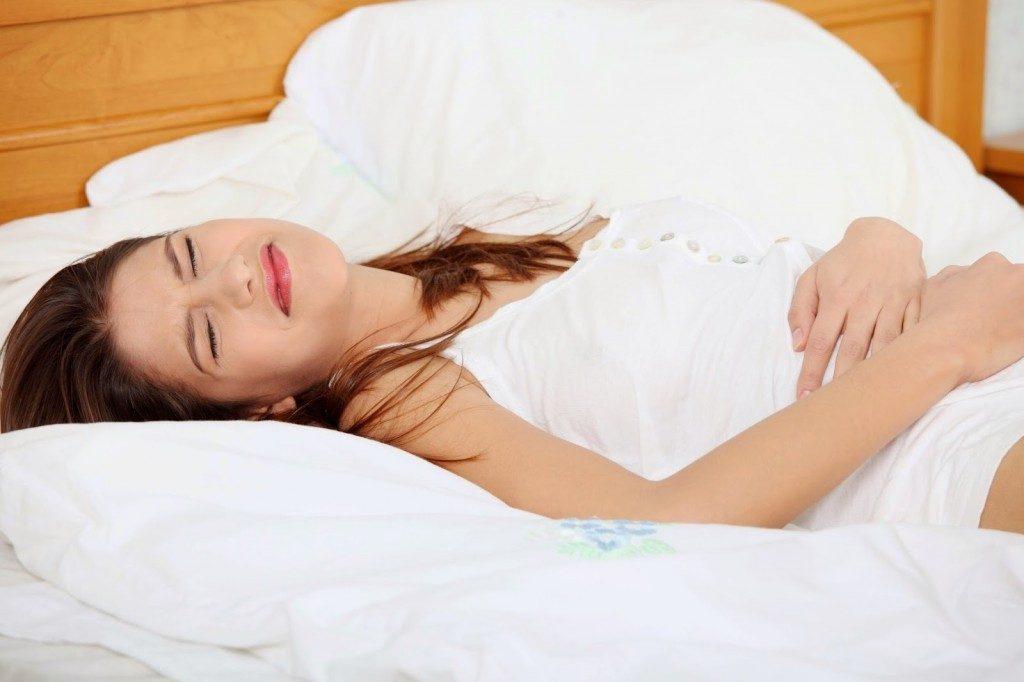 Đau bụng là dấu hiệu thụ thai thành công.